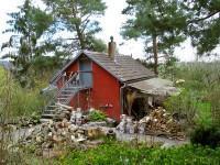 Gartenhaus aus Holz oder Blech?