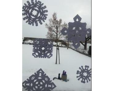 Winterzauber: Schneeflocken aus Scherenschnitt