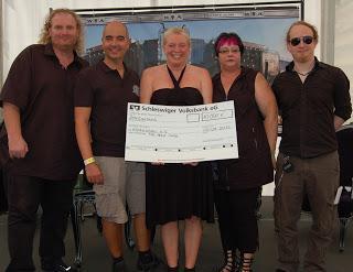 Full Metal Cruise-Tombola bringt 10.000 Euro für KinderLeben e.V: TUI Cruises spendet 1.000 Euro für Wacken Foundation